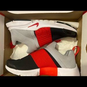 Grey, White Black and Red Nike Sneakers.
